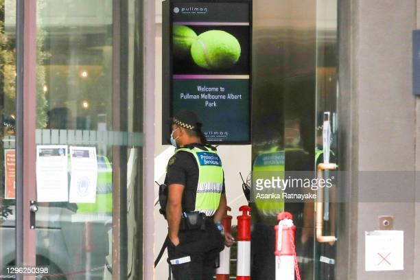 Protective service officer wearing a mask is seen in the lobby of The Pullman Hotel in Albert Park which is one of the three hotels being used for...