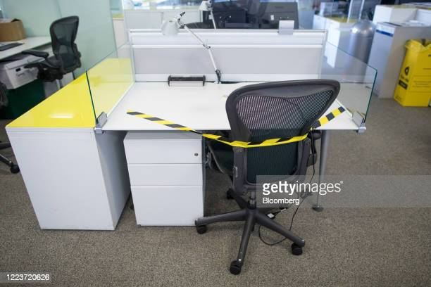 Protective tape is attached to a chair at a workstation at offices in London UK on Wednesday June 24 2020 Companies are getting ready to welcome more...