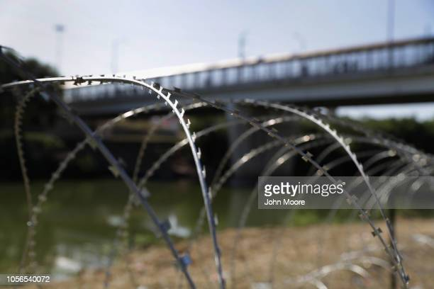 Protective wire stretches along the Rio Grande after being installed by US Army troops at the USMexico border on November 2 2018 in Hidalgo Texas US...