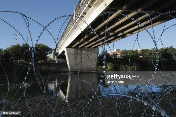 Protective wire stretches along the Rio Grande after being installed by US Army troops at the USMexico border on November 3 2018 in Hidalgo Texas US...