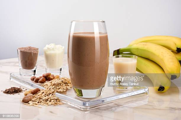protein drink with chocolate - protein drink stock pictures, royalty-free photos & images