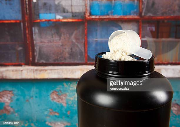 Protein powder and black plastic container