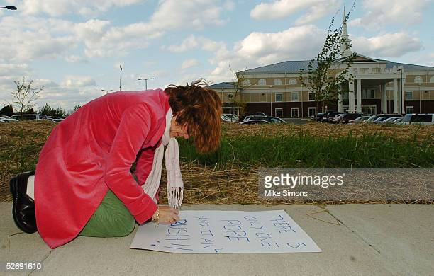 Proterster Karin Soltav makes a sign in front of Highview Baptist Church during the Justice Sunday nationwide simulcast April 24 2005 in Louisville...