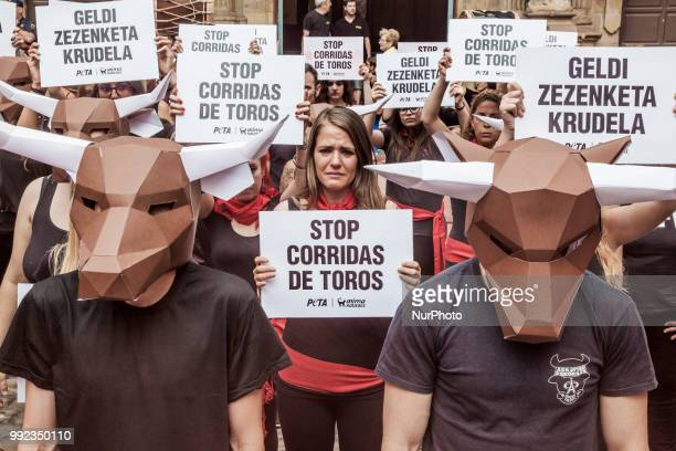 Protest against animal cruelty in bull fightings before San Fermin celebrations in Pamplona Spain Banner says quotstop bullfightingsquot and some...