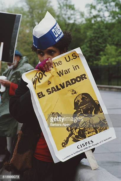 A protest against US involvement in El Salvador New York City April 1987 One protestor holds a CISPES poster