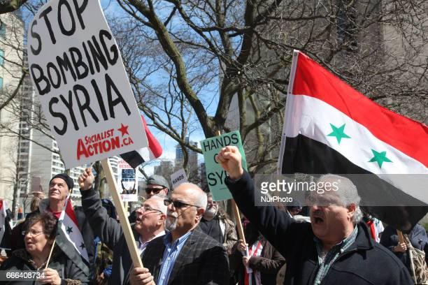 Protest against US President Donald Trump's decision to launch airstrikes against Syria on April 8 2017 in Toronto Ontario Canada Protestors gathered...