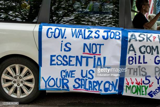 Protest at Governor Tim Walz's mansion to reopen Minnesota, Car with protest signs.