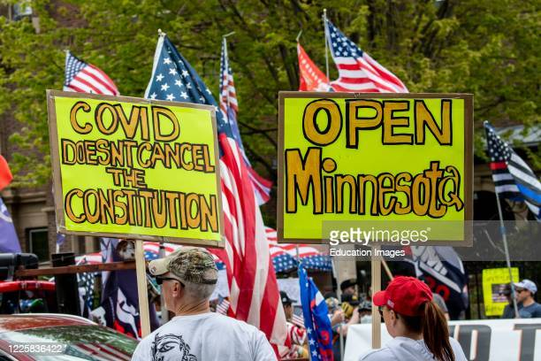 Protest at Governor Tim Walz's mansion to reopen Minnesota, Covid Doesn't Cancel Constitution sign.