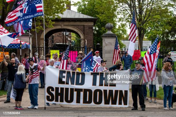 Protest at Governor Tim Walz's mansion to reopen Minnesota, End the Shutdown sign.