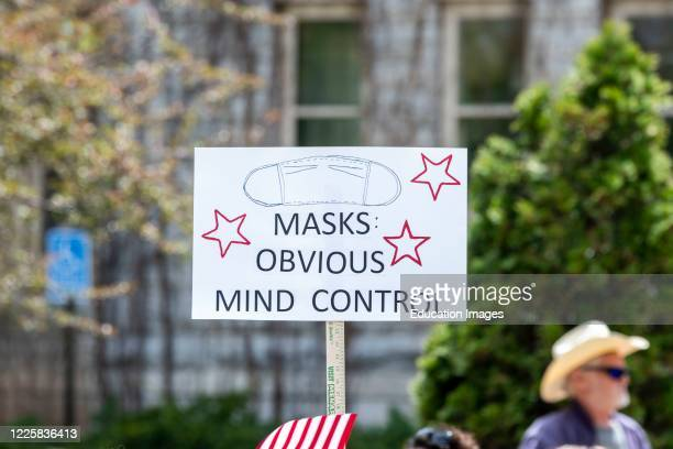 Protest at Governor Tim Walz's mansion to reopen Minnesota, Masks are Obvious Mind Control sign.