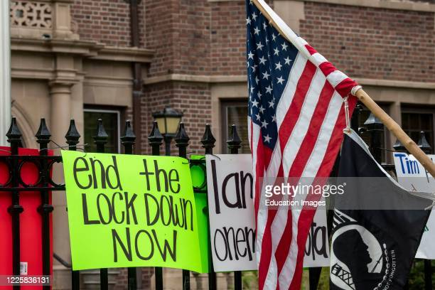 Protest at Governor Tim Walz's mansion to reopen Minnesota, Protest sign posted on the fence.
