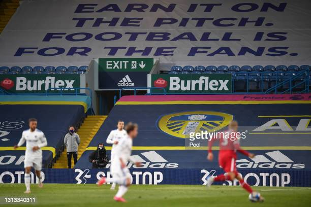 """Protest Banner against the European Super League is seen inside the stadium that reads """"Earn it on the pitch. Football is for the fans"""" during the..."""