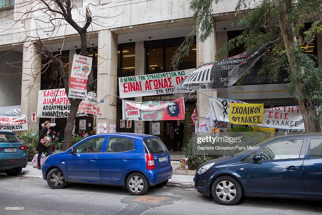 Protest banners hang from the Ministry of Finance now run by economist and Finance Minister for the Greek government, Yanis Varoufakis. Photographed for Paris Match on March 6, 2015 in Athens, Greece.