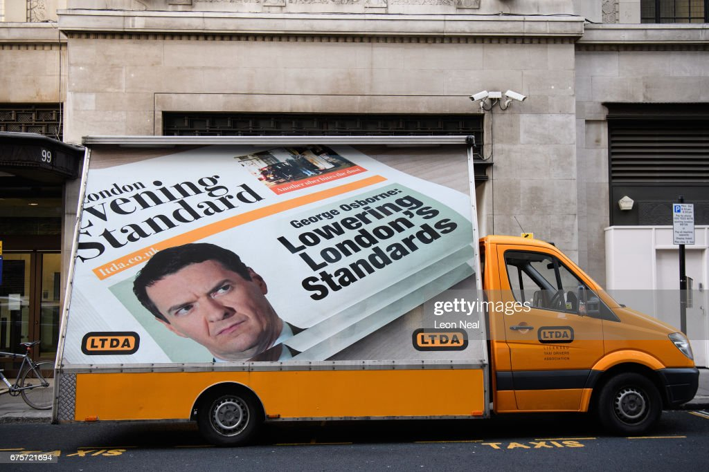 A protest billboard is seen as former Chancellor of the Exchequer George Osborne begins his first official day in the role of editor of the London Evening Standard newspaper, on May 2, 2017 in London, England. Mr Osborne announced that he was stepping down from his seat as MP for Tatton following criticism for accepting the media position.