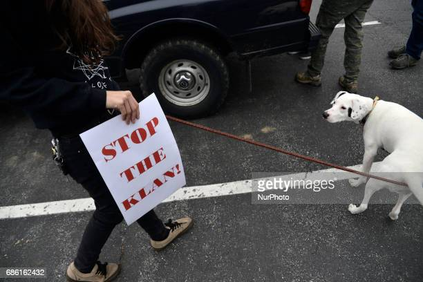A protest caravan of local activist gathers on a parking lot ahead of a drive back country roads in Lancaster County PA on May 20 2017 to protest the...