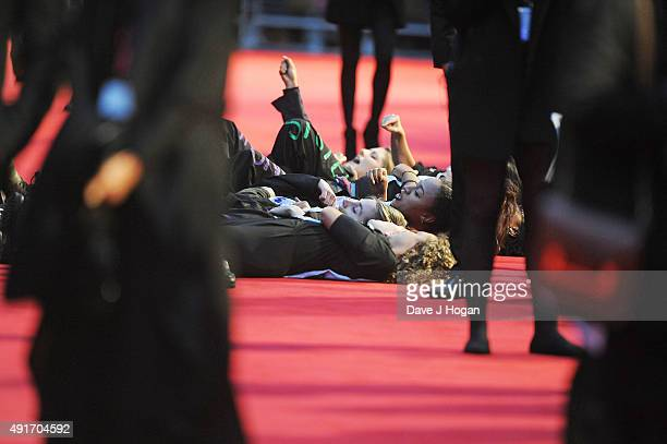 """Protest during the screening of """"Suffragette"""" on the opening night of the BFI London Film Festival at Odeon Leicester Square on October 7, 2015 in..."""