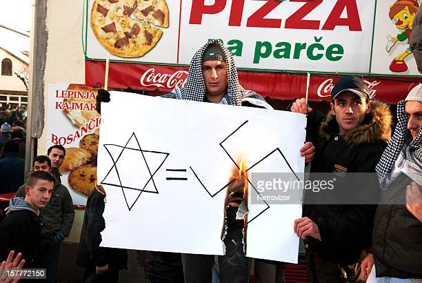 protest for palestine, january, 2009. - nazi swastika stock pictures, royalty-free photos & images