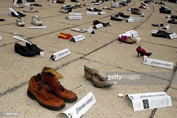 Protest for the missing people in Mexico Against the drug traffickers put your shoes at the Angel of Independence on July 10 2011 in Mexico City