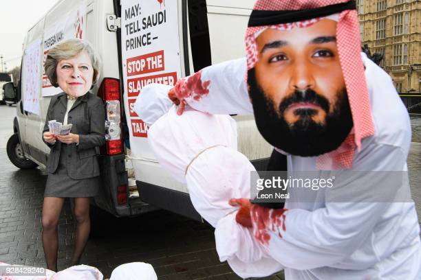 Protest group Avaaz stages a demonstration against the ongoing violence in Yemen with actors dressed as British Prime Minister Theresa May and Saudi...