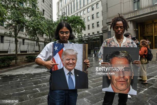 A protest group called Hot Mess hold up signs of Jeffrey Epstein and President Donald Trump in front of the Federal courthouse on July 8 2019 in New...