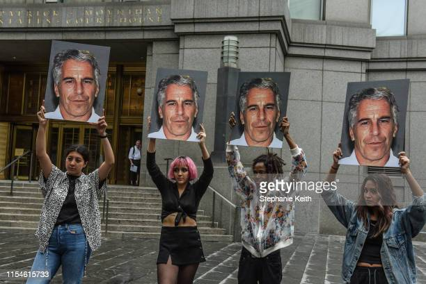 A protest group called Hot Mess hold up signs of Jeffrey Epstein in front of the Federal courthouse on July 8 2019 in New York City According to...