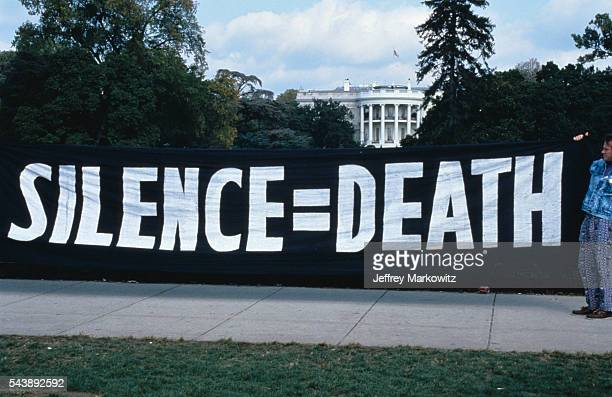 AIDS protest in front of the White House ACT UP activists hang a 'silence = death' banner on the White House gates