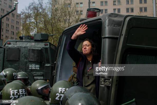 Protest in the center of Santiago de Chile, nearing the commemoration of a new anniversary of the 1973 coup d'etat on 5 September 2019, in Santiago,...