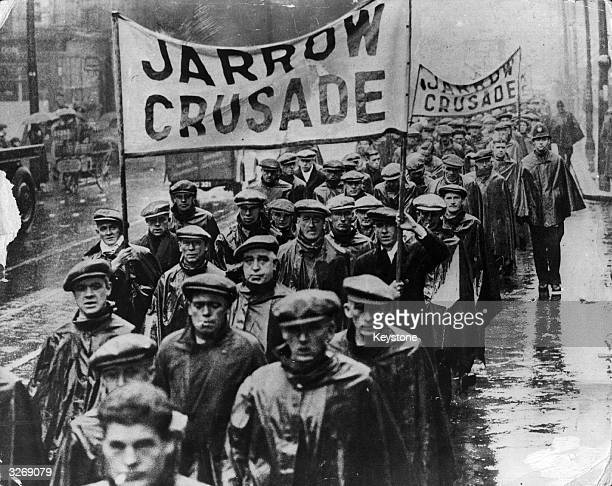 Protest marchers on the Jarrow Crusade, a demonstration march by unemployed men from shipyard town of Jarrow, Tyneside, who walked to London to...
