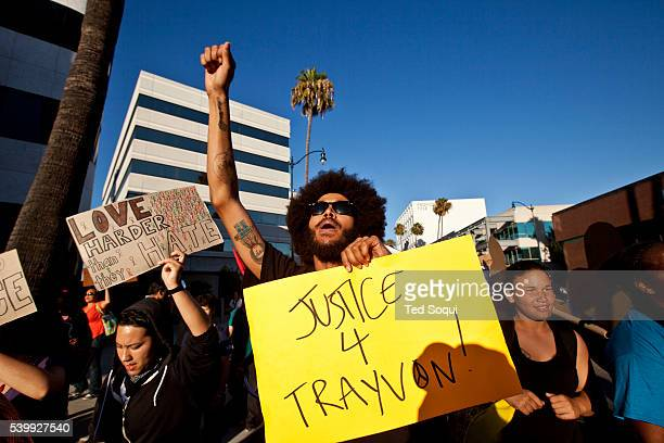 Protest marches through the posh city of Beverly Hills, in response to the Trayvon Martin murder verdict. Around 200 people marched up to Rodeo...