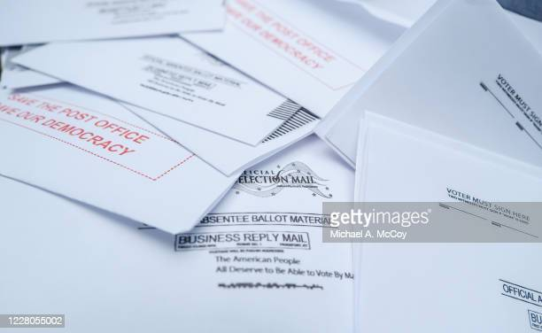 Protest material that resemble mail-in election ballots are seen as demonstrators gather on Kalorama Park to protest President Donald Trump donor and...