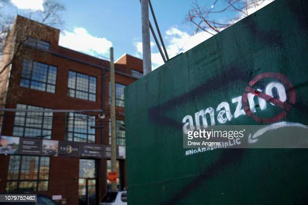 A protest message directed at Amazon is spray painted on a wall near a construction site January 9 2019 in the Long Island City neighborhood of the...