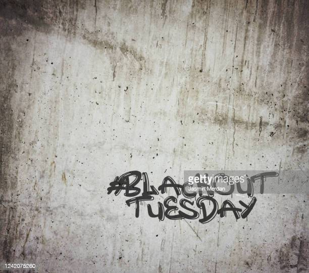protest message in usa against racism graffiti - blackout tuesday stock pictures, royalty-free photos & images