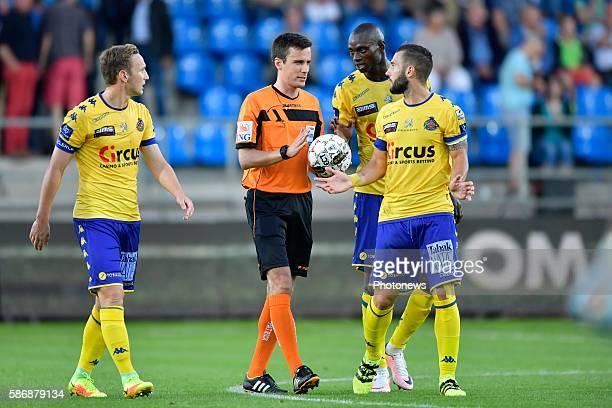 Protest of Floriano Vanzo midfielder of Beveren, Francois Marquet midfielder of Beveren and Jonathan Buatu Mananga defender of Beveren during the...