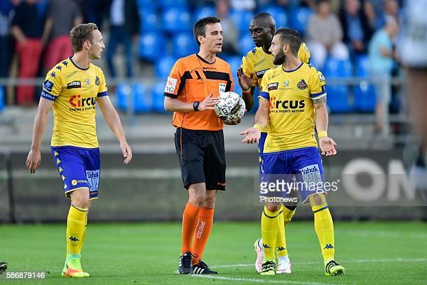 Protest of Floriano Vanzo midfielder of Beveren, Francois Marquet midfielder of Beveren and Jonathan Buatu Mananga defender of Beveren in discussion...