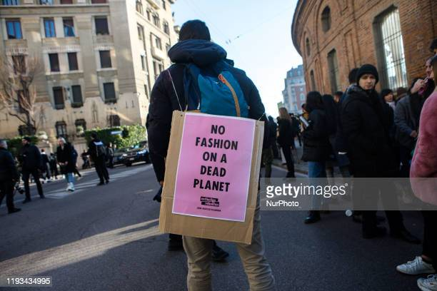 Protest of the sociopolitical movement Extinction Rebellion at the entrance to the Salvatore Ferragamo fashion show Milan Italy on 12 January 2020...