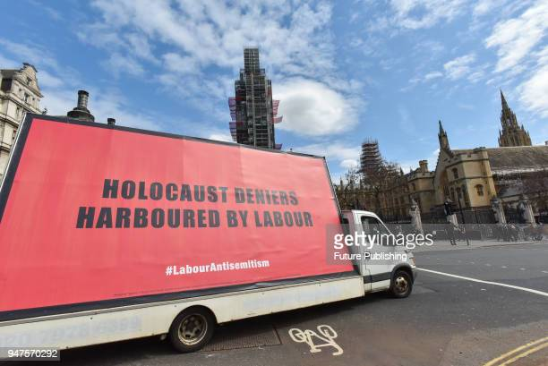A protest of three billboards being driven around against antisemitism in the Labour party goes around Parliament Square on April 17 2018 in London...