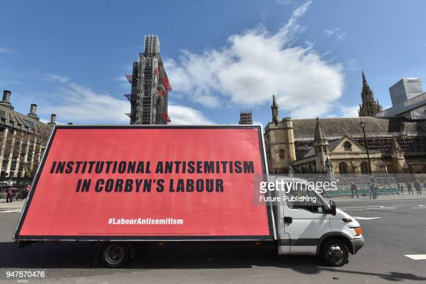 Protest of three billboards being driven around against antisemitism in the Labour party goes around Parliament Square on April 17, 2018 in London,...