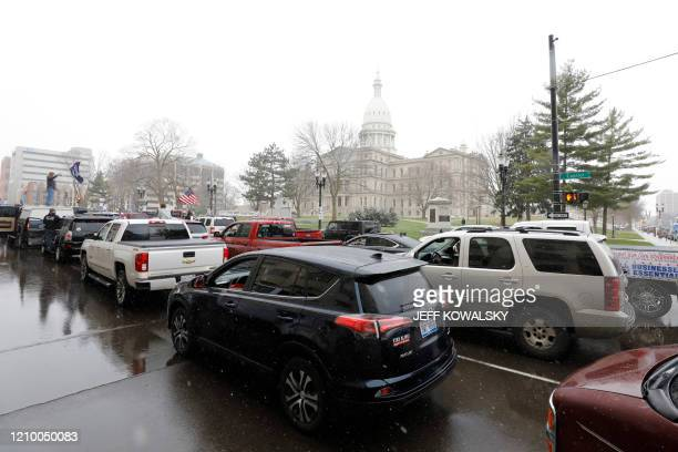 A protest organized by Michiganders Against Excessive Quarantine drives around the Michigan State Capitol in Lansing Michigan on April 15 2020 The...