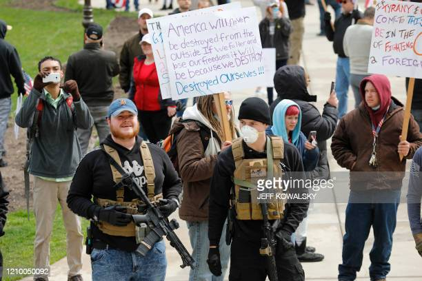 A protest organized by Michiganders Against Excessive Quarantine gather around the Michigan State Capitol in Lansing Michigan on April 15 2020 The...