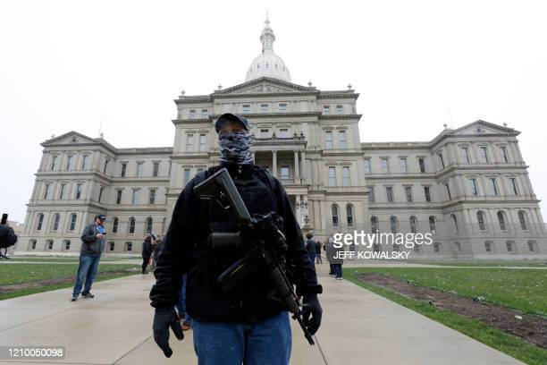 A protest organized by Michiganders Against Excessive Quarantine gathers around the Michigan State Capitol in Lansing Michigan on April 15 2020 The...
