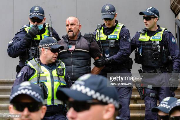 Protest organizer, Craig is arrested during the Coronavirus Anti-Lockdown Protest at Parliament House on 10 May, 2020 in Melbourne, Australia.