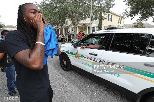 Protest organizer Miles Mulrain Jr. Yells at a sheriffs deputy vehicle outside a home in Windermere, Florida, on Friday, May 29 The home is owned by...