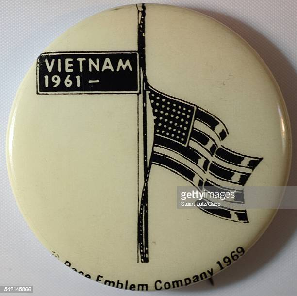 A protest pin consisting of a white background and an American flag illustration rendered in black that features a start date of 1961 which was the...