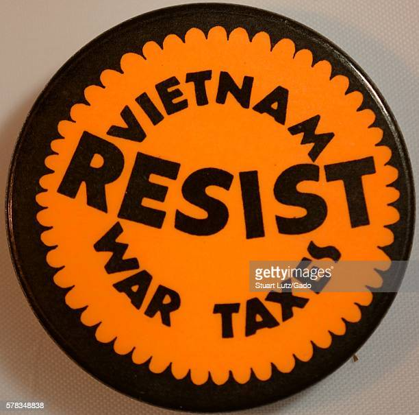 A protest pin that reads 'Resist Vietnam War taxes' it was created due to the public backlash against congressional approval of President Johnson's...