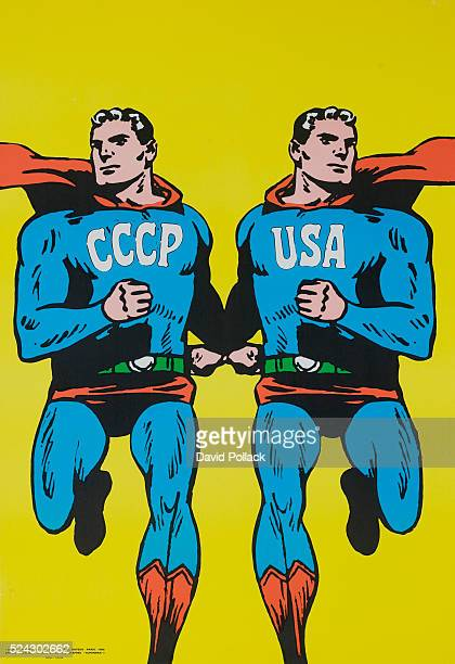 Protest poster illustrated by Roman Cieslewicz showing two identical Supermen, one with CCCP and one with USA marked on their costumes