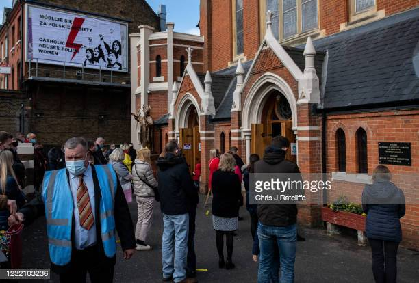Protest poster on a billboard reads Catholic church abuses Polish women outside the Christ the King Polish Roman Catholic church on April 4, 2021 in...