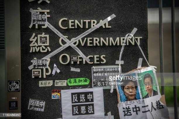 Protest posters hang on the signage by the entrance to the Legislative Council building on June 18 2019 in Hong Kong Hong Kongs Chief Executive...