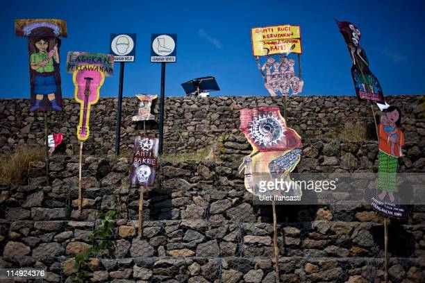 Protest posters sits in front of dam that is containing mud during the 5th Anniversary of Lusi mud volcano disaster on May 29 2011 in the subdistrict...