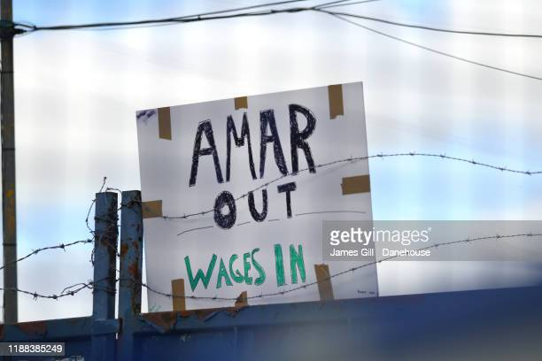 Protest sign aimed at Amar Alkadhi the owner of Macclesfield Town is seen during the FA Cup First Round match between Macclesfield Town and...