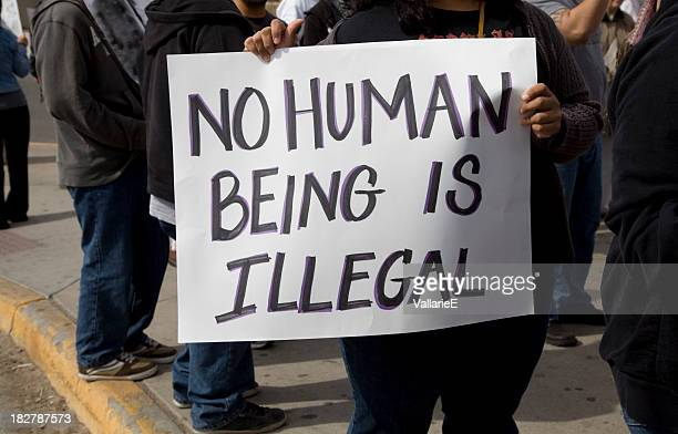 protest sign - emigration and immigration stock pictures, royalty-free photos & images